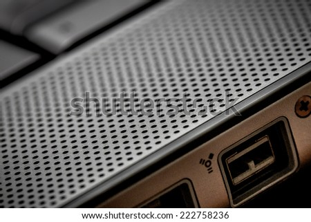 Closeup up of computer laptop selective focus on firewire port ideal for technology network night hacker cyber crime - stock photo
