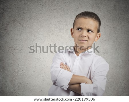 Closeup up portrait headshot suspicious, cautious child boy looking up with disbelief, skepticism isolated grey wall background. Human facial expressions emotions body language perception attitude - stock photo