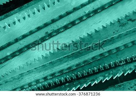 Closeup various hacksaw blades pattern. Toned. - stock photo
