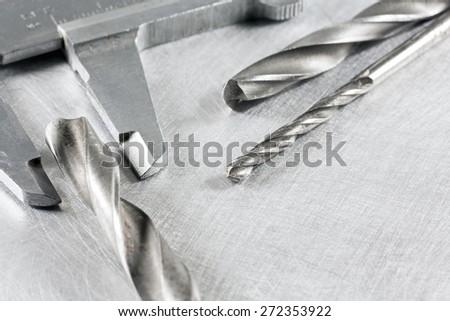 Closeup vernier caliper measure diameter of drill bits - stock photo