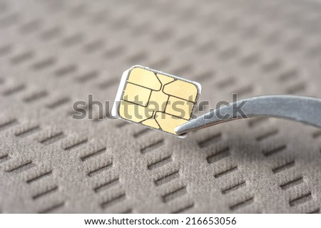closeup very small Nano SIM card - stock photo