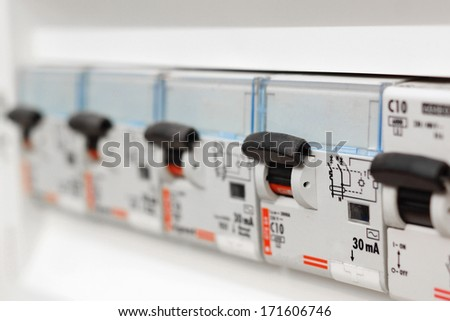 Closeup view of a box with automatic fuses - stock photo