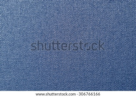 closeup view of a fragment of blue cloth with a heavy woven pattern and texture. - stock photo