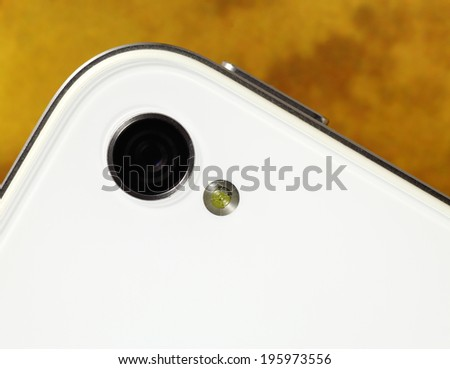 Closeup view of a mobile phone camera with lighting flash.  - stock photo