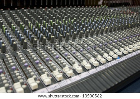 closeup view of a sound mixing desk - stock photo