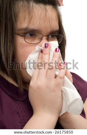 Closeup view of a young girl wiping her runny nose