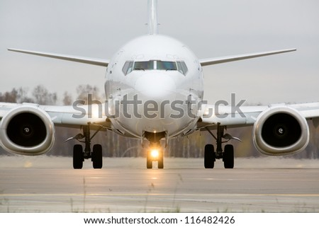 Closeup view of an aircraft preparing to take off - stock photo
