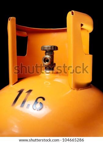 Closeup view of an orange gas bottle with 11,6 kilos od gas. - stock photo