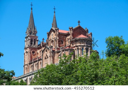 Closeup view of Basilica of Santa Maria in Covadonga over the trees, Asturias, Spain - stock photo