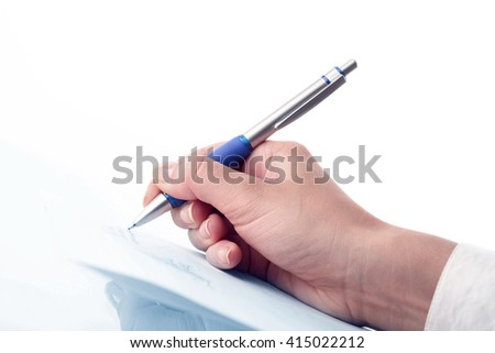 Closeup view of businessman hand signing a document - stock photo