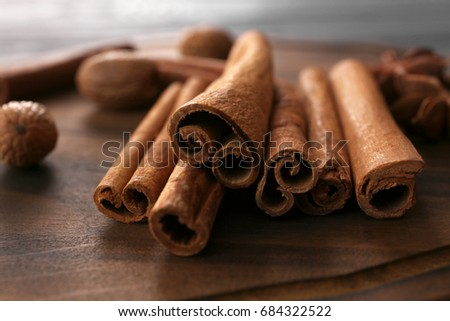 Closeup view of cinnamon sticks on wooden surface