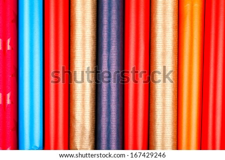 Closeup view of colorful wrapping paper rolls  - stock photo