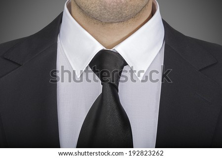 Closeup view of jacket and tie against grey background, Italian fashion concept - stock photo