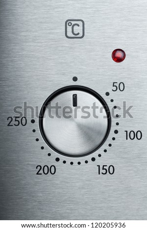 Closeup view of metallic handle of modern oven - stock photo