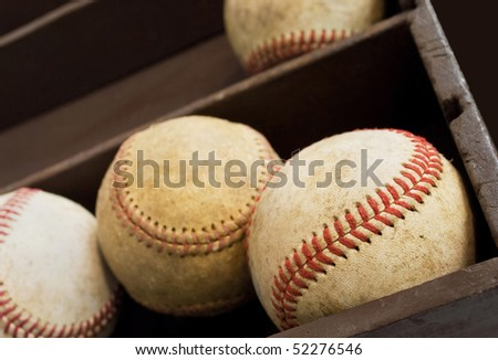 closeup view of old baseballs in a wooden box - stock photo