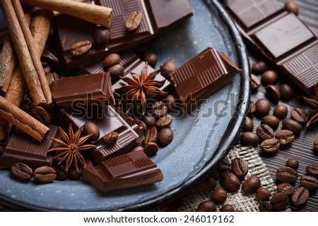 Closeup view of old plate with spices, chocolate and coffee beans - stock photo