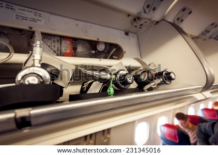 Closeup view of oxygen cylinders at aircraft - stock photo