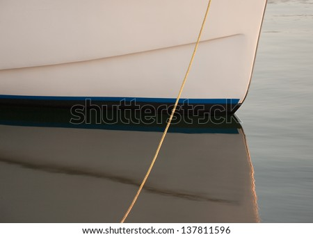 Closeup view of small boat hull and reflection - stock photo