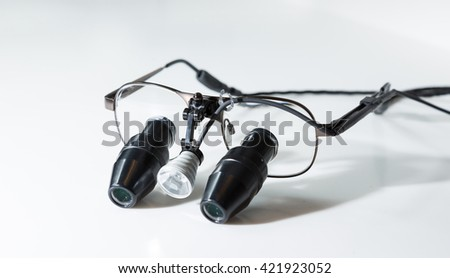 Closeup view of some magnifying loupes for dentists or watchmakers - stock photo