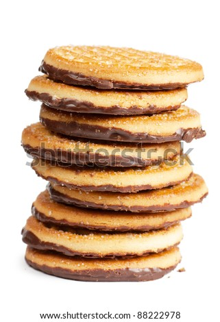 Closeup view of stack of cookies with chocolate over white background