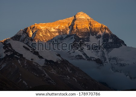 Closeup view of the north face of Mt. Everest at sunset, Tibet - stock photo