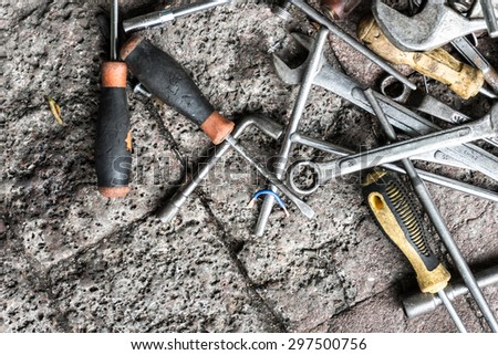 closeup view of work tools on brick ground