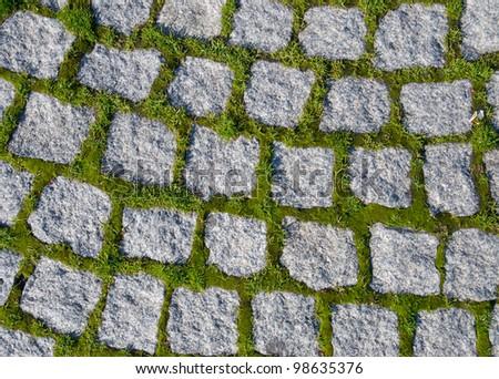 Closeup view on a cobblestone road - stock photo