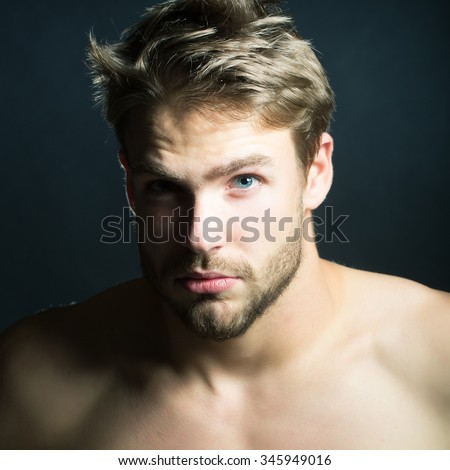 Closeup view portrait of one handsome young muscular naked sexy macho man with short hair bare chest a?d beautiful body standing in studio on black backdrop, square picture - stock photo