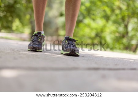 Closeup walking feet outdoors. Fitness, jogging, healthy lifestyle concept. - stock photo