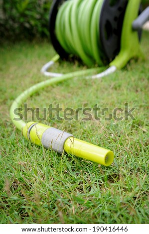 closeup watering garden hose head - stock photo