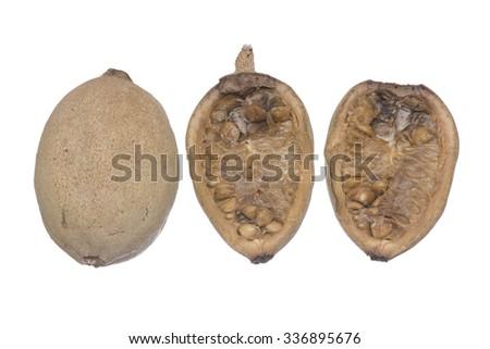 Closeup whole and cross section Genipa americana jenipapo fruit isolated on white background - stock photo