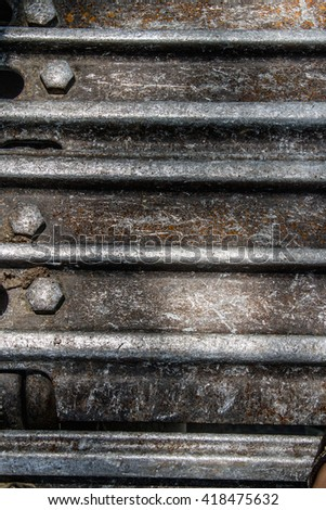 Closeup wide angle view of the tracks of an excavator  - stock photo