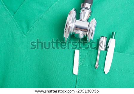 Closeup with stethoscope and pen in scrubs pocket - stock photo