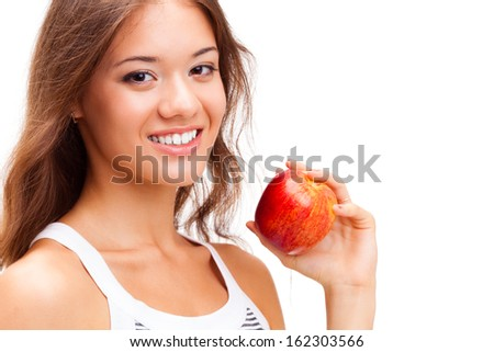 closeup woman face portrait with apple in hand - stock photo