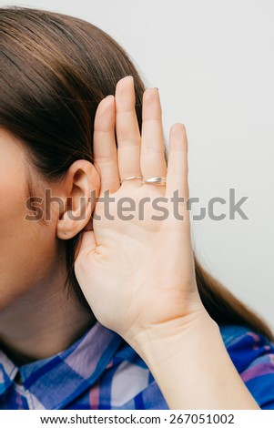 Closeup woman, girl with hand to ear listening secret gossip or quiet sound. - stock photo