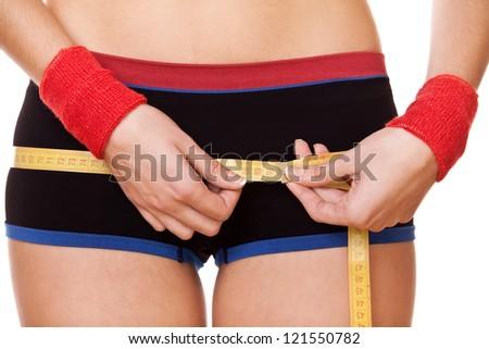 closeup woman measuring perfect shape of beautiful hips 90 centimeters - stock photo