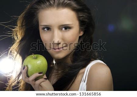 Closeup woman portrait with apple - stock photo