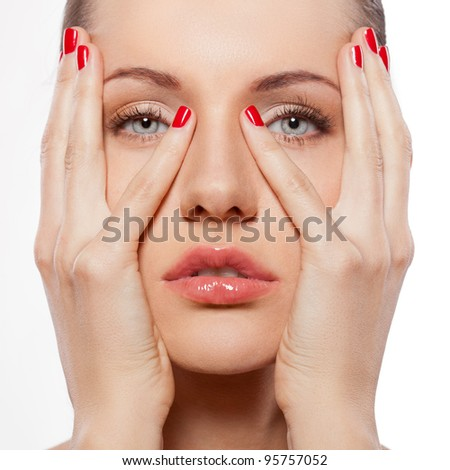 closeup woman portrait with hands on face