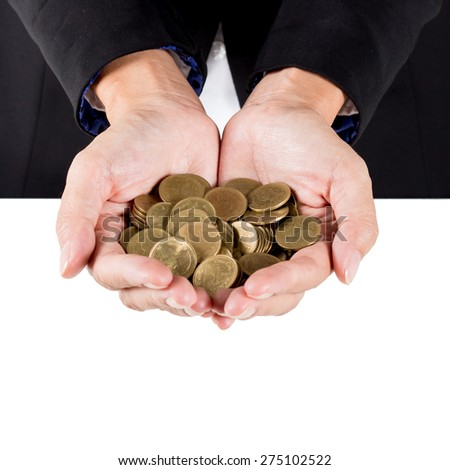 closeup woman's hands holding world coins, Business woman hands and saving concepts. - stock photo