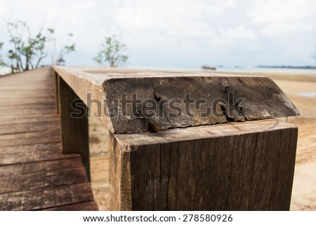 closeup wooden railing on wood bridge,thailand - stock photo