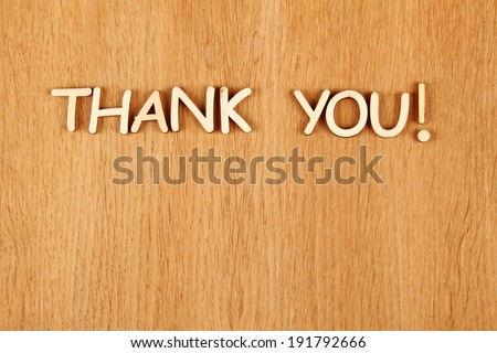 "Closeup wooden words ""Thank you"" on a wooden background - stock photo"