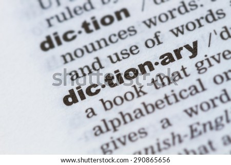 closeup word dictionary  in dictionary, soft focus, - stock photo