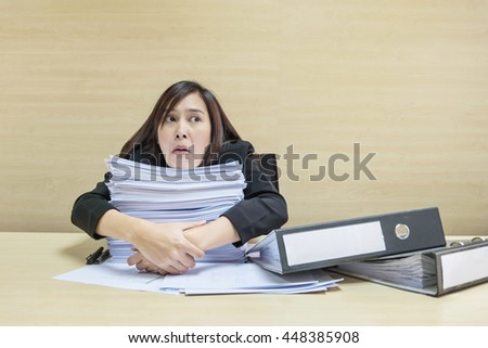 Closeup working woman boring pile work stock photo 448385908 closeup working woman are boring from pile of work paper and document file in front of publicscrutiny Images