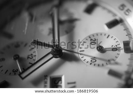 Closeup wristwatch on black background - stock photo