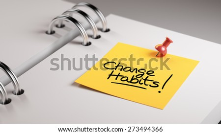 Closeup Yellow Sticky Note paste it in a notebook setting an appointment. The words Change Habits written on a white notebook to remind you an important appointment. - stock photo
