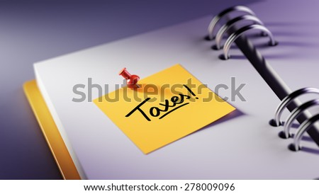 Closeup Yellow Sticky Note paste it in a notebook setting an appointment. The words Taxes written on a white notebook to remind you an important appointment. - stock photo