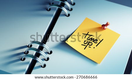 Closeup Yellow Sticky Note paste it in a notebook setting an appointment. The words Time up written on a white notebook to remind you an important appointment. - stock photo