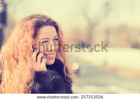 Closeup young beautiful smiling woman talking on cell phone. Positive face expression emotion  - stock photo