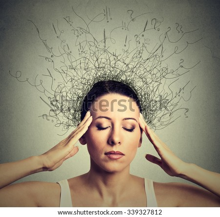 Closeup young woman with worried stressed face expression eyes closed trying to concentrate with brain melting into lines question marks deep thinking. Obsessive compulsive, adhd, anxiety disorders  - stock photo