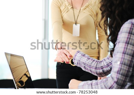 Closing a successful deal with woman  handshake. Congratulations! - stock photo
